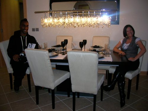 Hannah and Simon of Dreamwall testing out the dining suite in a Palm island apartment Dubai