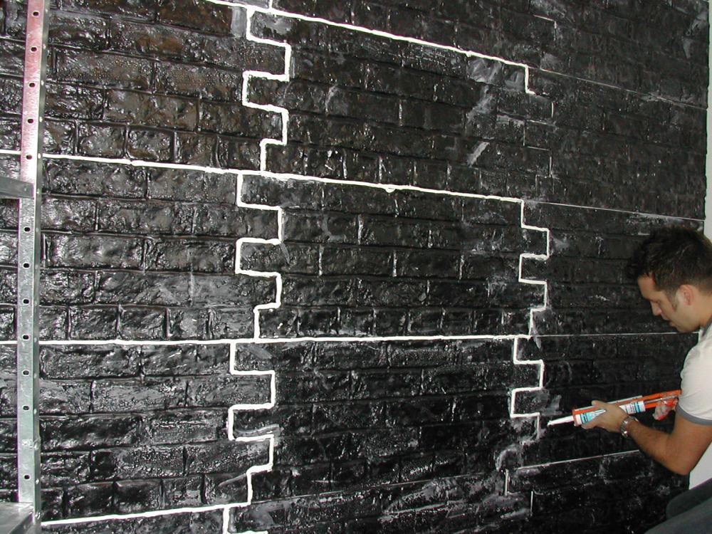 A Rustic Brick wall being installed before any decoration