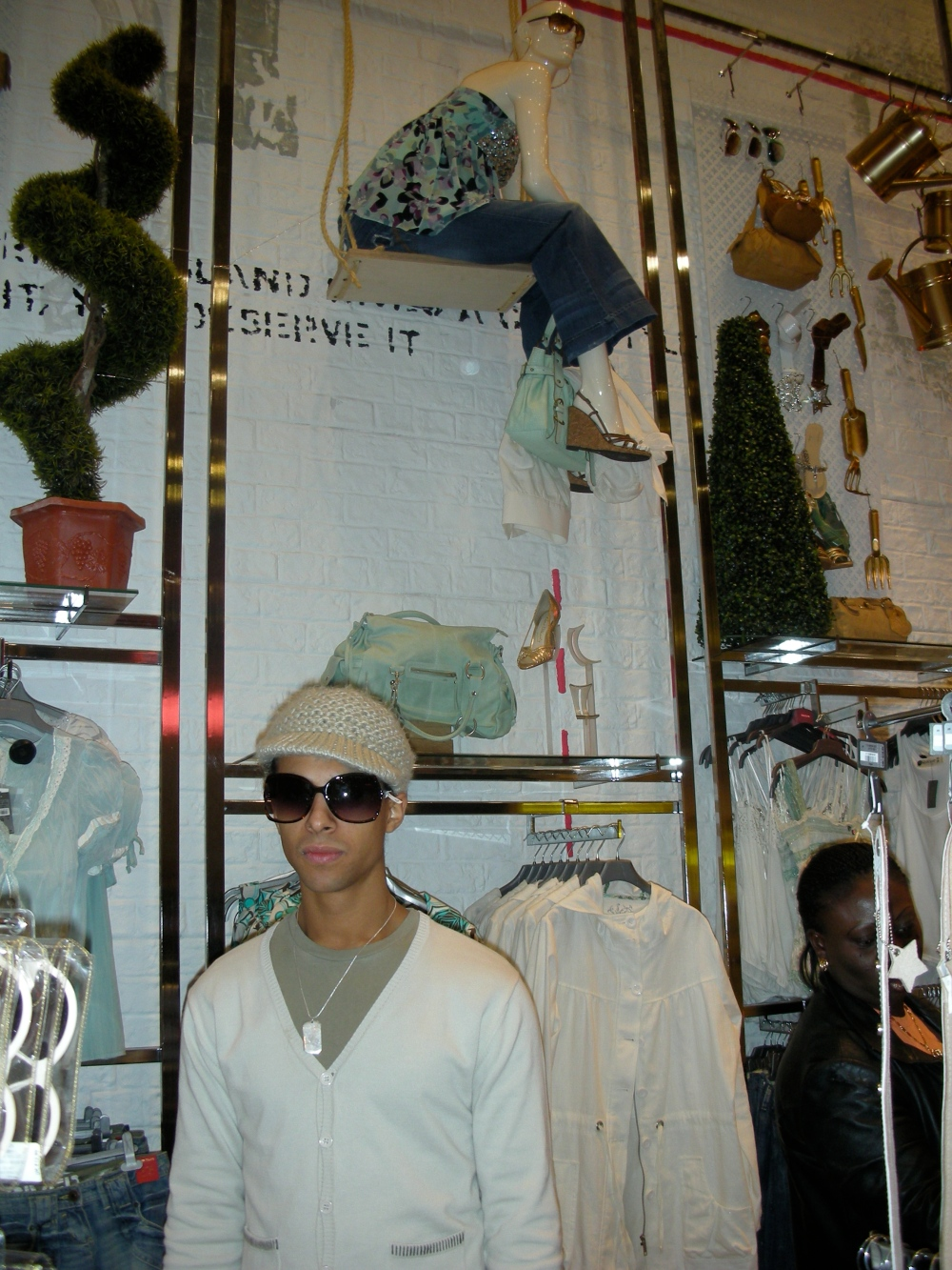 Marvin Humes from x factor boyband JLS next to Dreamwall's Rustic Brick feature wall in River Island Oxford Street