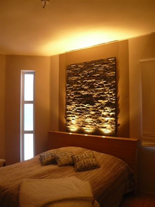 Fake slate panel in bedroom headboard in slate for Rock bedroom designs