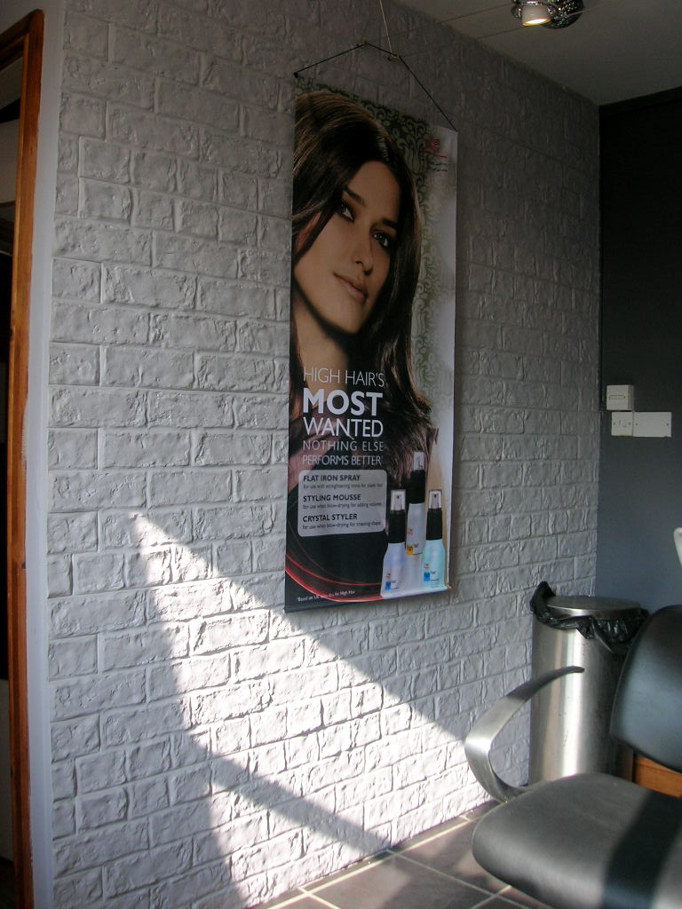 RUSTIC BRICK PAINTED GREY IN A HAIRDRESSERS