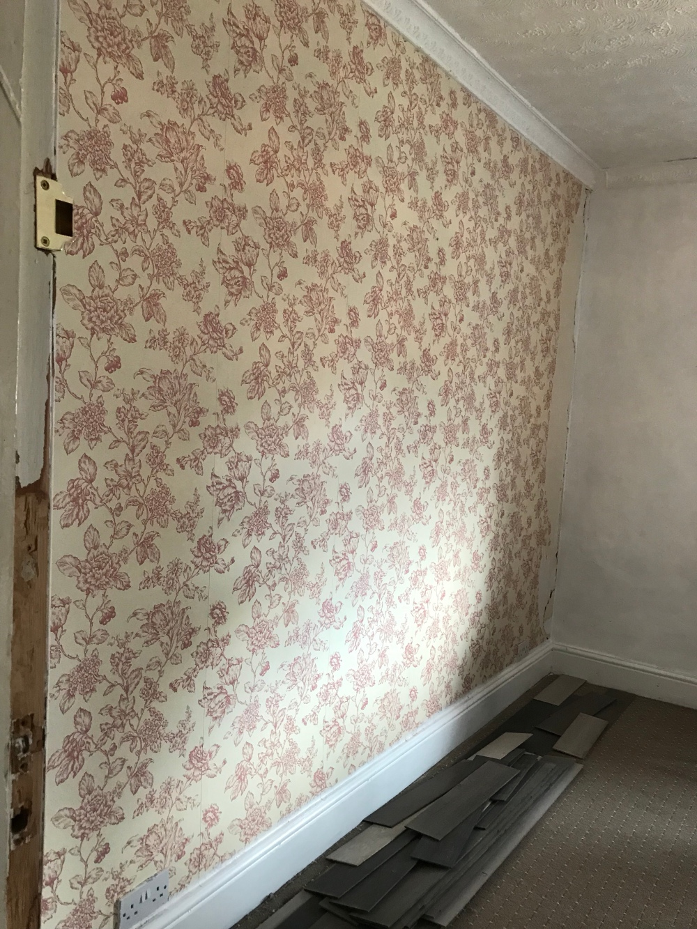 Before Image of a dated floral wallpaper