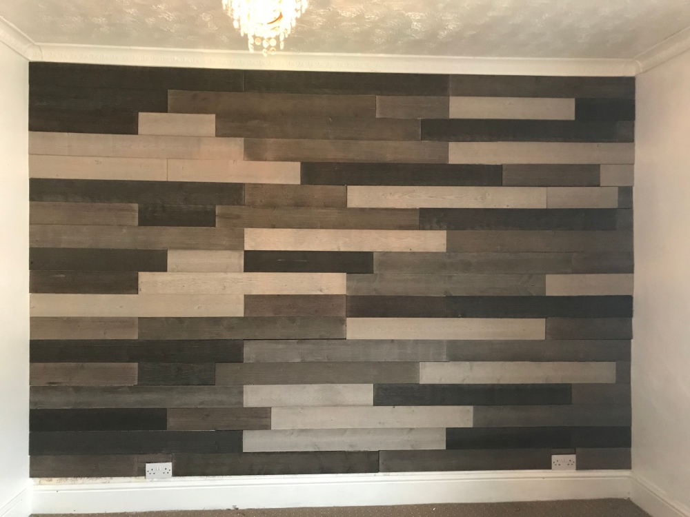 Wall transformation creating a statement timber feature wall